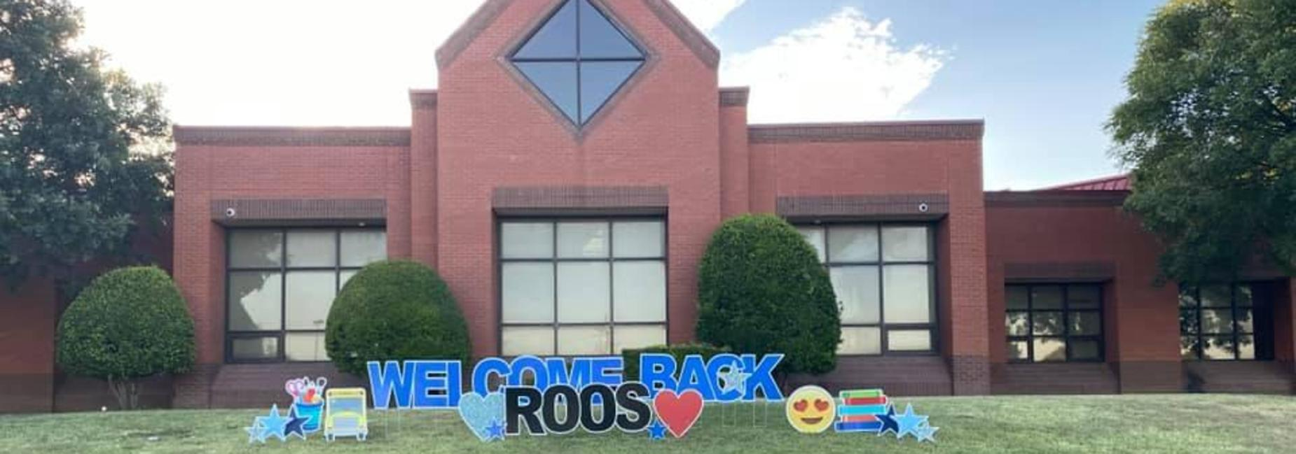 photo of Austin Elementary with yard signage that spells out Welcome Back Roos