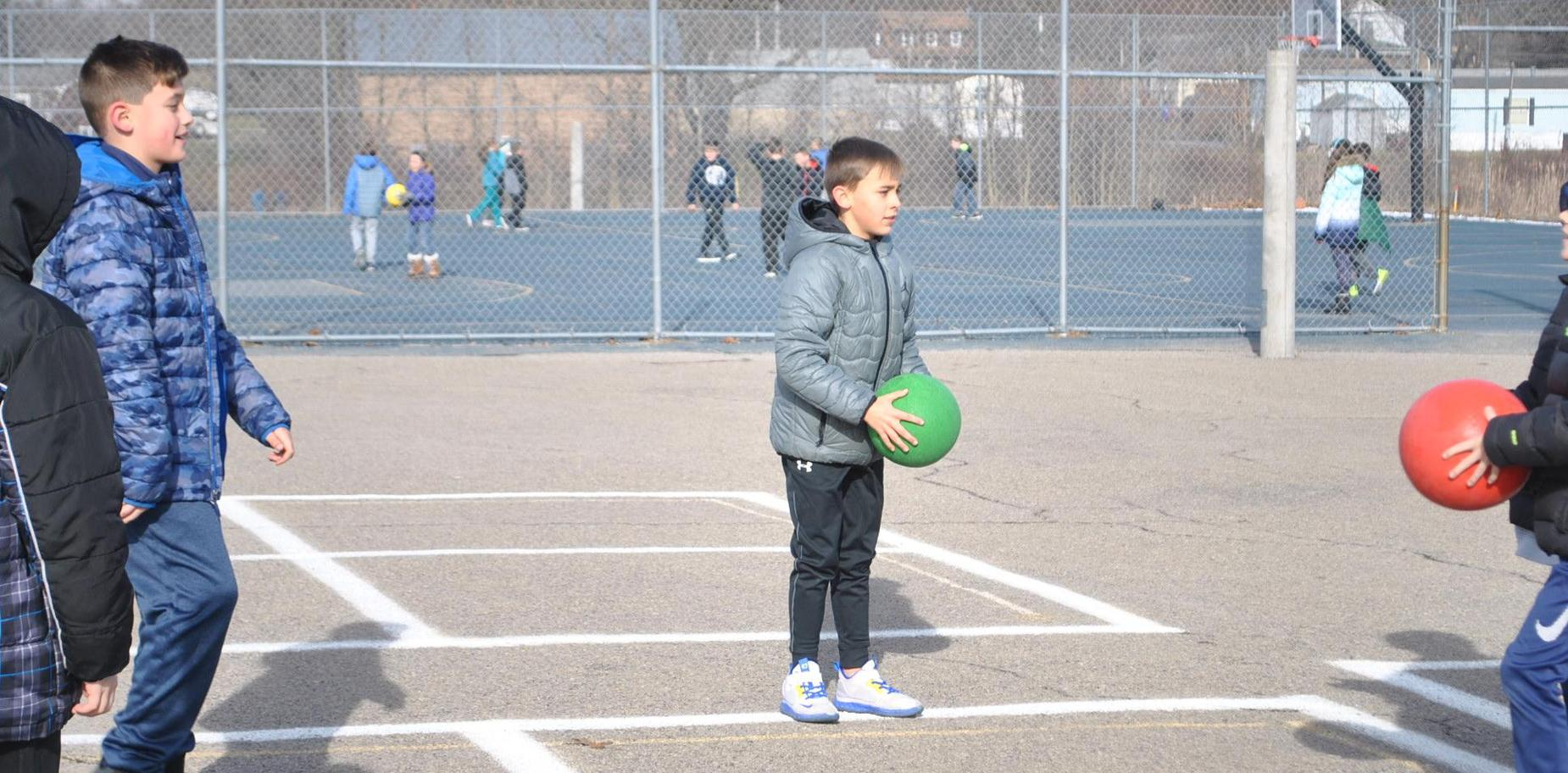 boy playing 4-square