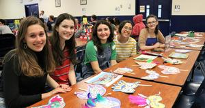 Westfield High School students celebrate cultural diversity at a May 2 event held for a third year offering presentations and performances, displays and demonstrations from around the world.  From left, Olivia Ebel, Emma Hanley, Chloe Shanebrook-Wein, Isabella Wolff, and Sally Crandall.