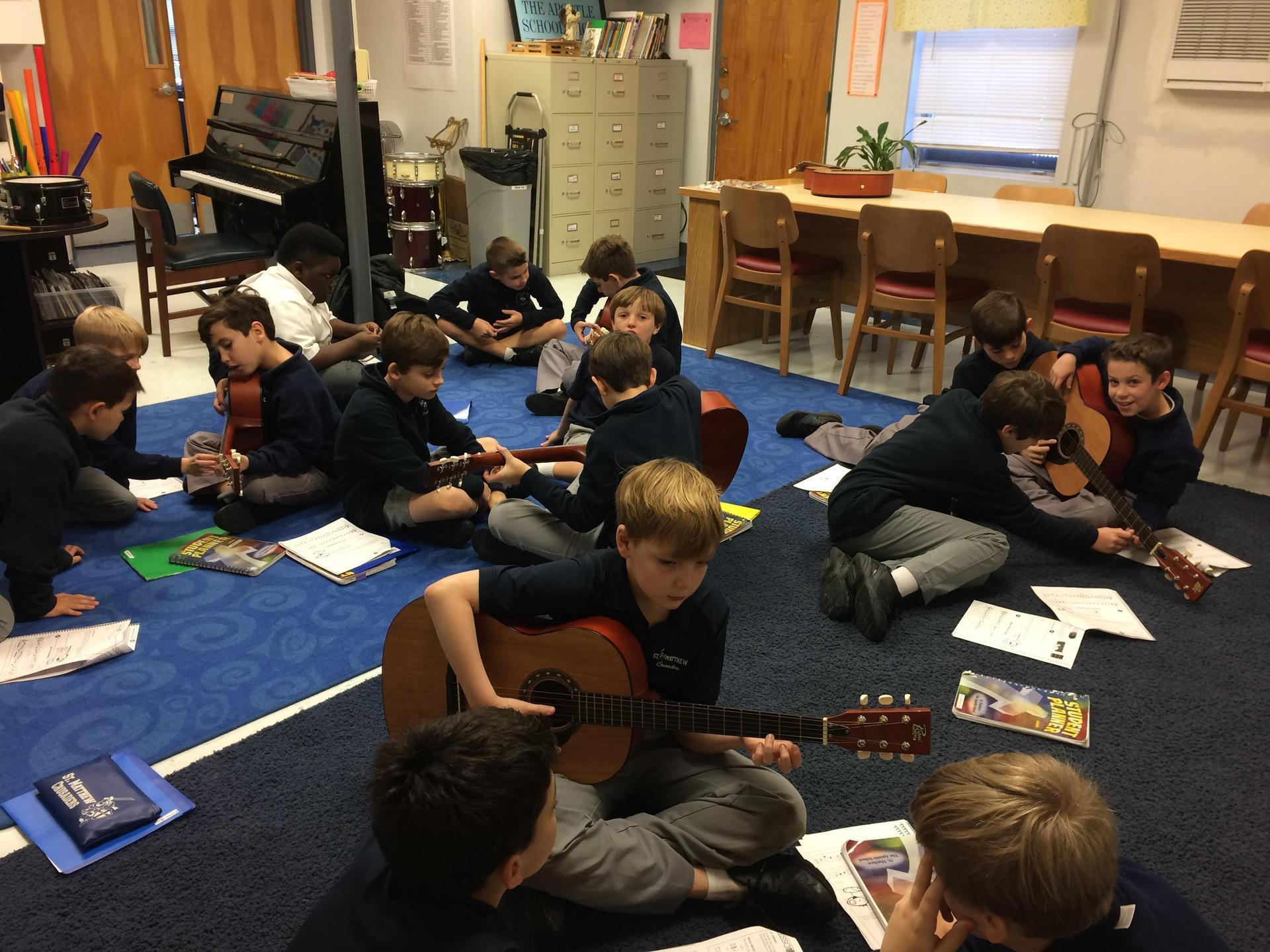 4th Grade Boys Learning Guitar