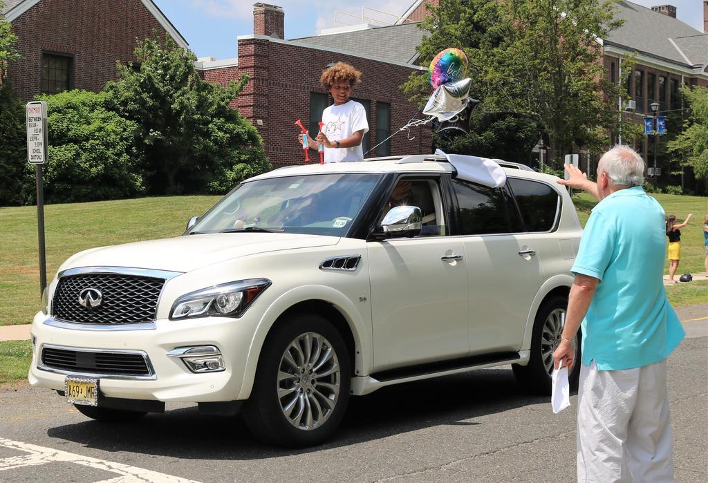 Photo of Wilson principal Joseph Malanga waving to student in Grade 5 Clap Out Car Parade.