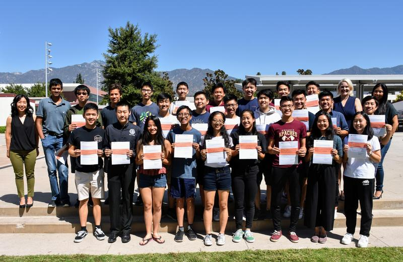 25 Arcadia High Students hold their National Merit Scholarship semifinalist notices