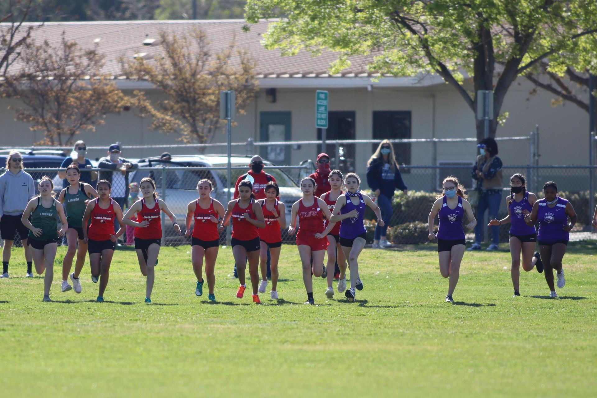 girls running at liberty high school