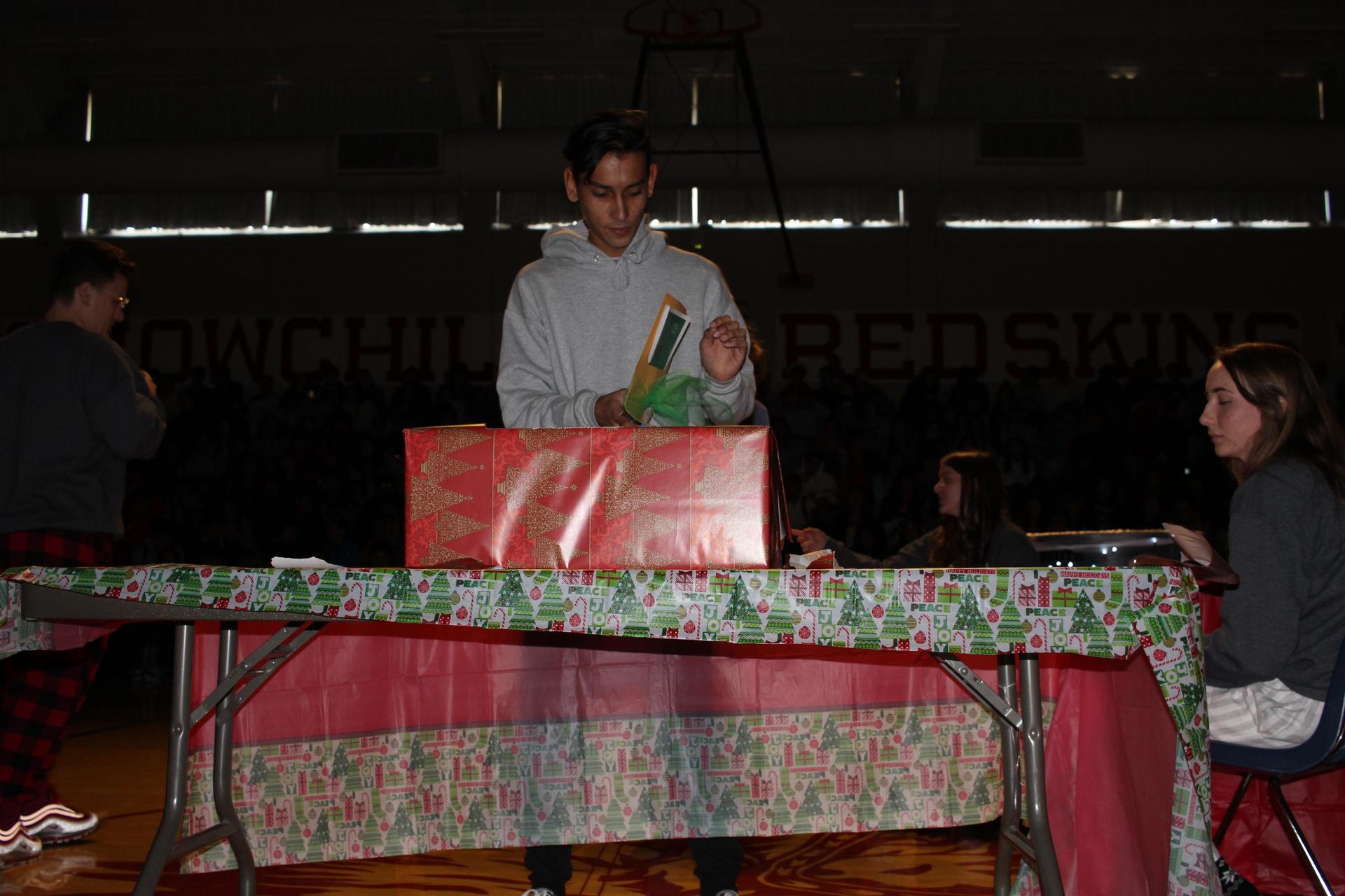 Nicholas Martinez opening his gift
