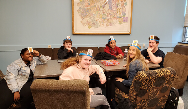 Students playing a game in Beth's Place, the senior lounge.
