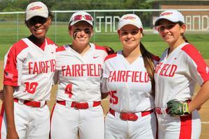 A photo of the four graduating seniors on the softball team.