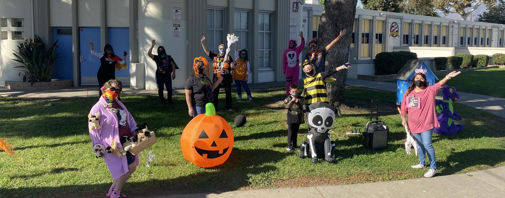 Cherrylee Staff Welcomes Students at Drive-Thru Halloween Event
