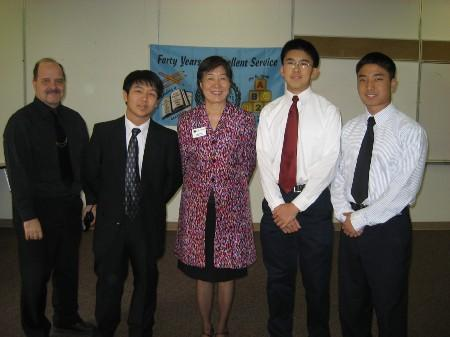 Three students with Assistant Principal