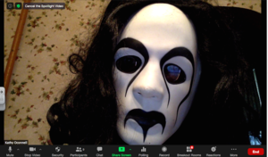 Mrs. O wearing scary mask