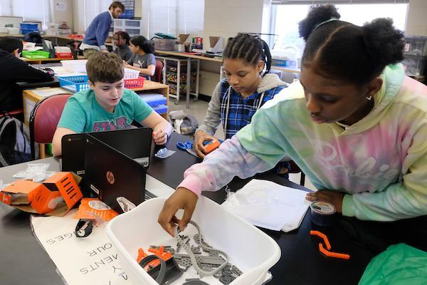 Students working in a classroom on robotics