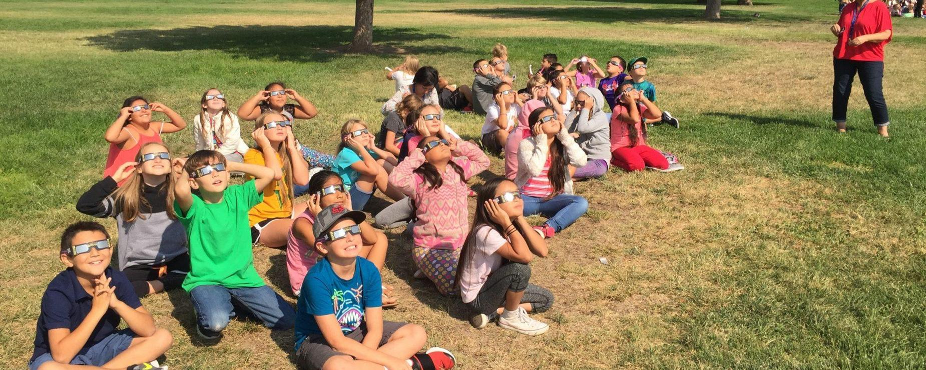 students viewing an eclipse