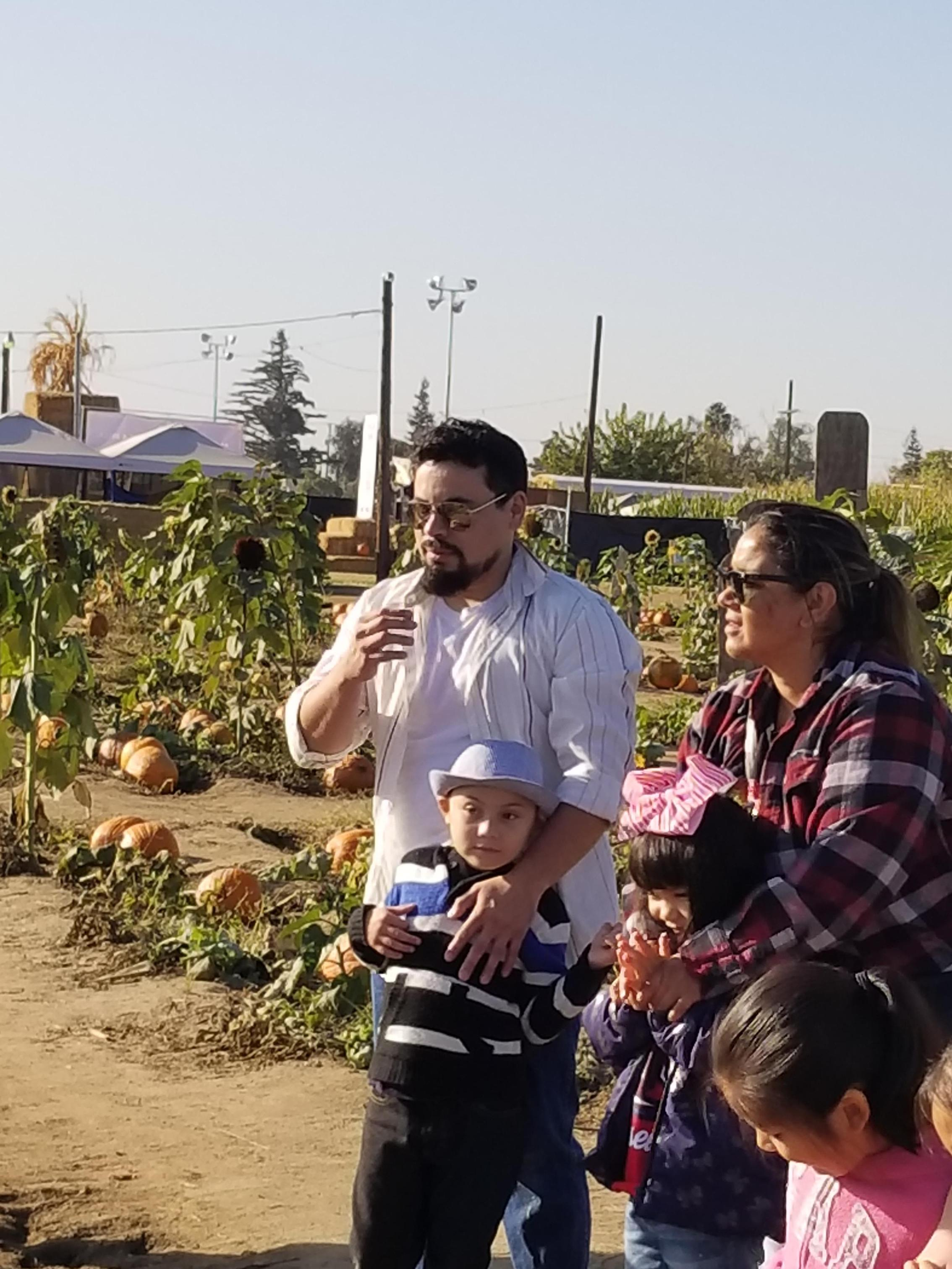 Parents and a student at the pumpkin patch.