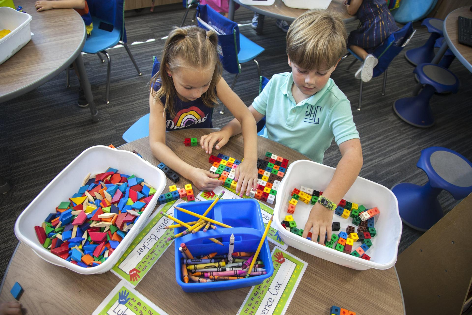 Students playing with lego blocks.
