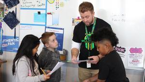 Students talking to teacher