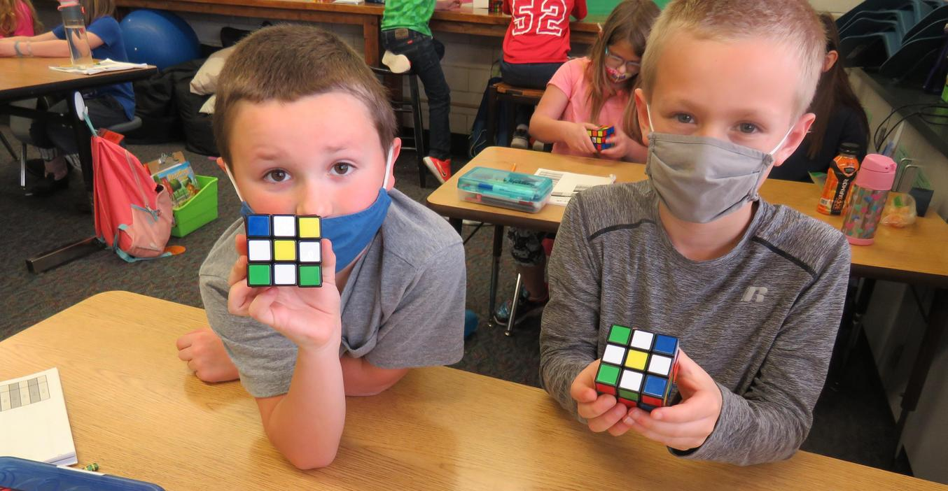 Lee students learn to solve the Rubik's Cube and make different designs.