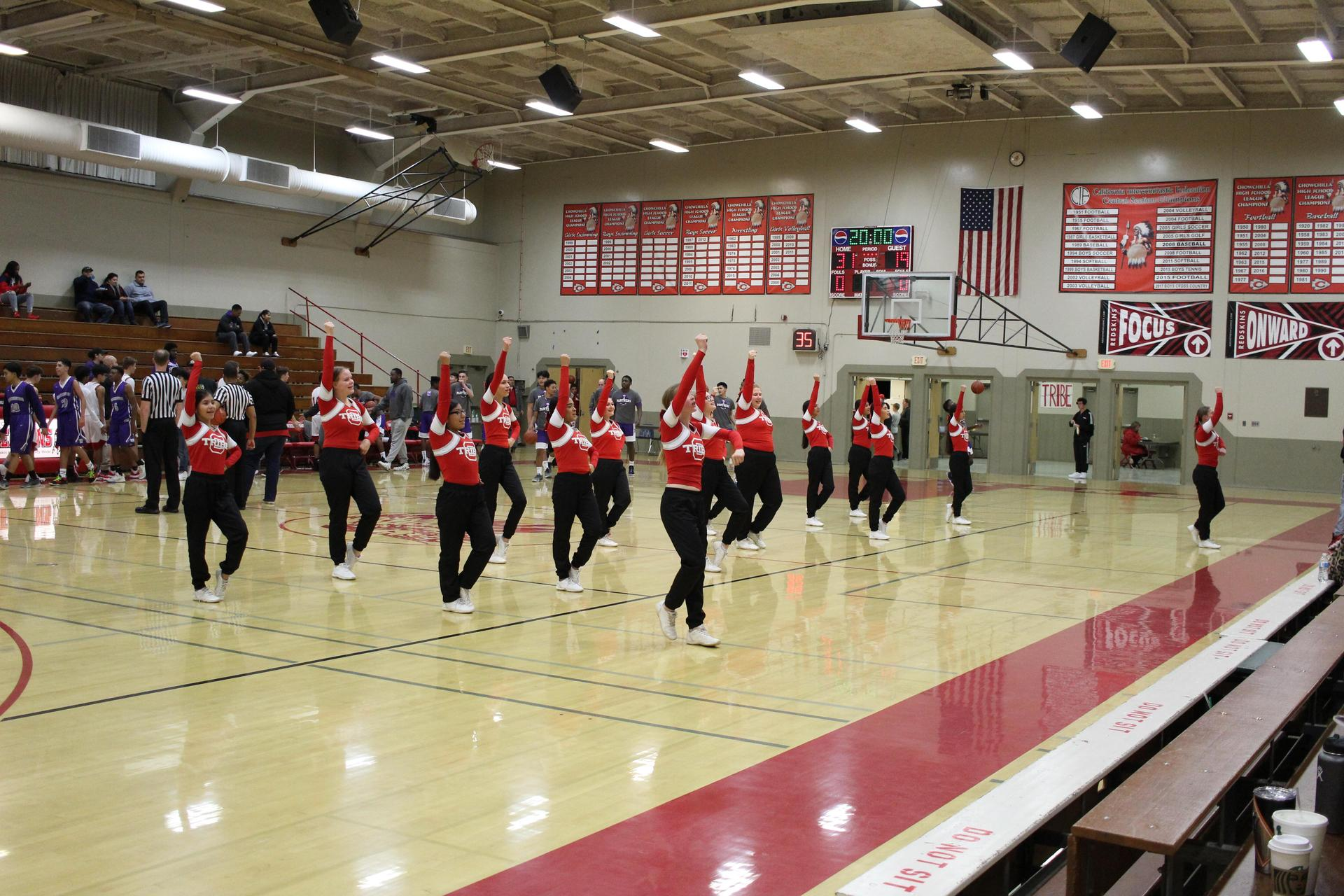 j v cheer doing their halftime performance during j v boys basketball