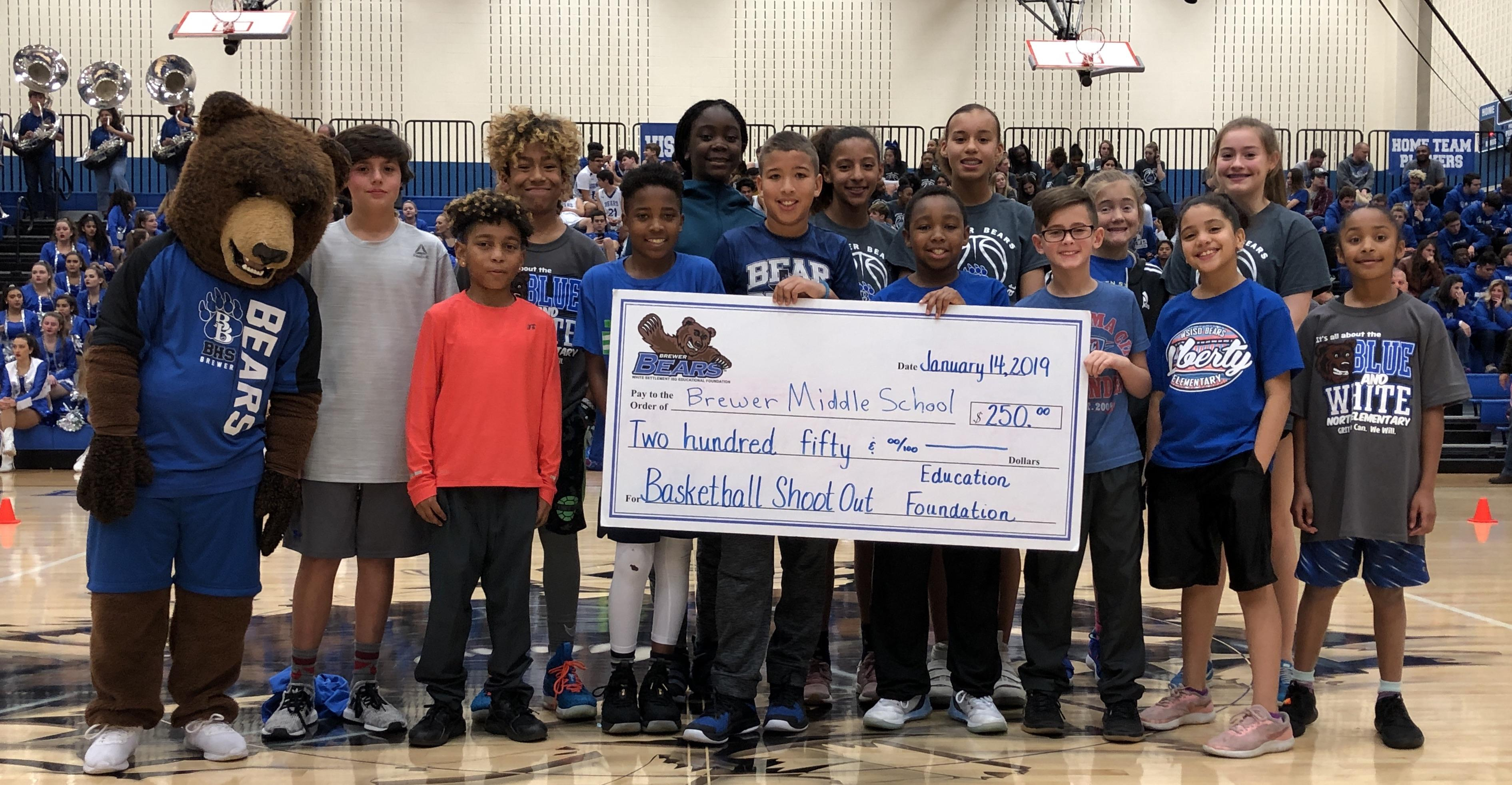 Select students competed in a Basketball Shootout and Soccer Kick Competition to win $250 each for their school.