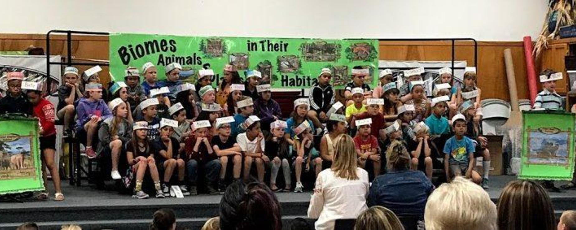 students performing an animal-related presentation