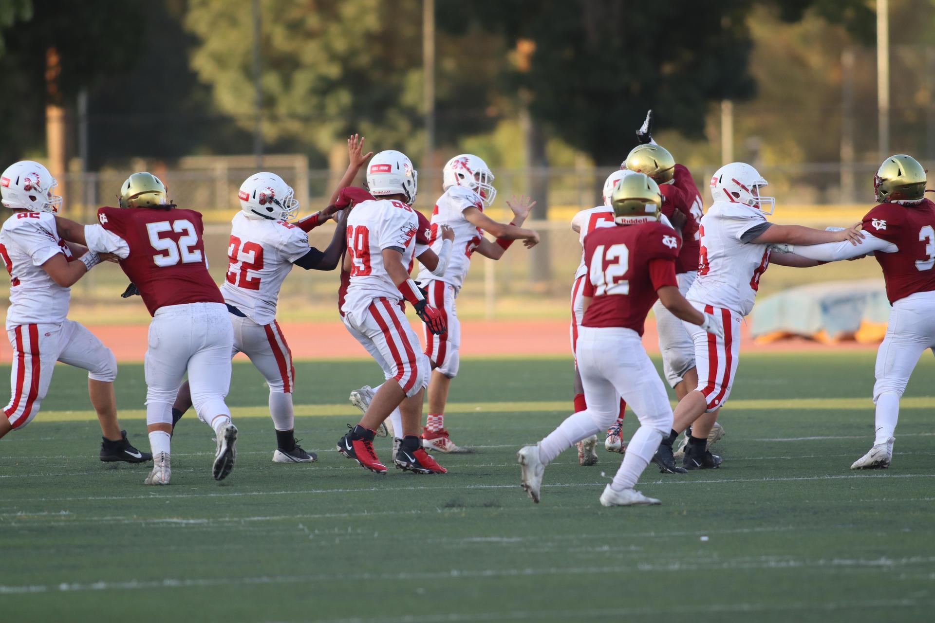 JV boys playing football against Golden Valley