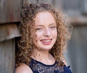 senior photo of girl in blue top