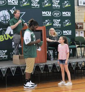 New York Jets Linebacker Lorenzo Mauldin visited Edison Intermediate School on May 4, praising students and staff for creating a supportive school culture that says no to bullying and yes to kindness and empathy.  Here he signs a football for a student.