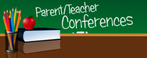 desk and chalkboard that says parent teacher conference