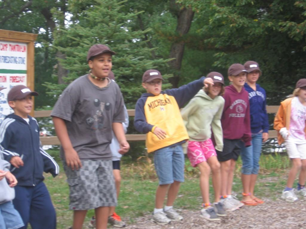 students in line at camp playing game