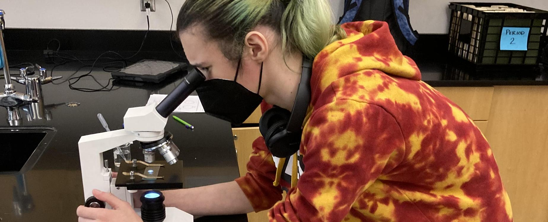 A student uses a microscope in a SHS science class