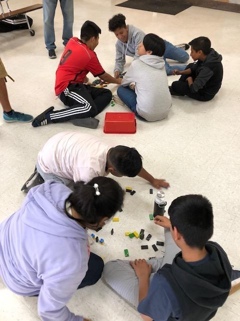 Students learn the difference between kinetic and potential energy during a Saturday STEM Academy.