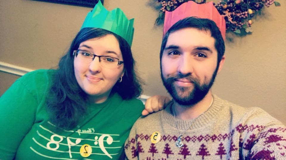 Ms. Butler and her brother, Brad, wearing paper crowns on Christmas Day 2017