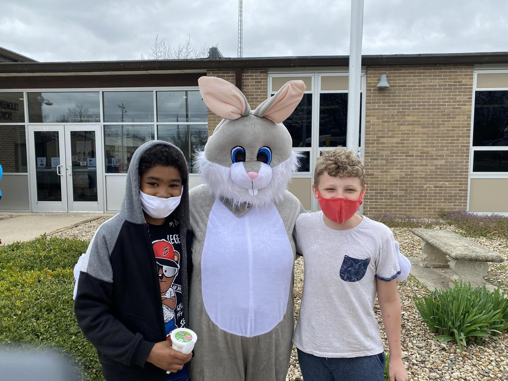 two CIS students with the Easter Bunny