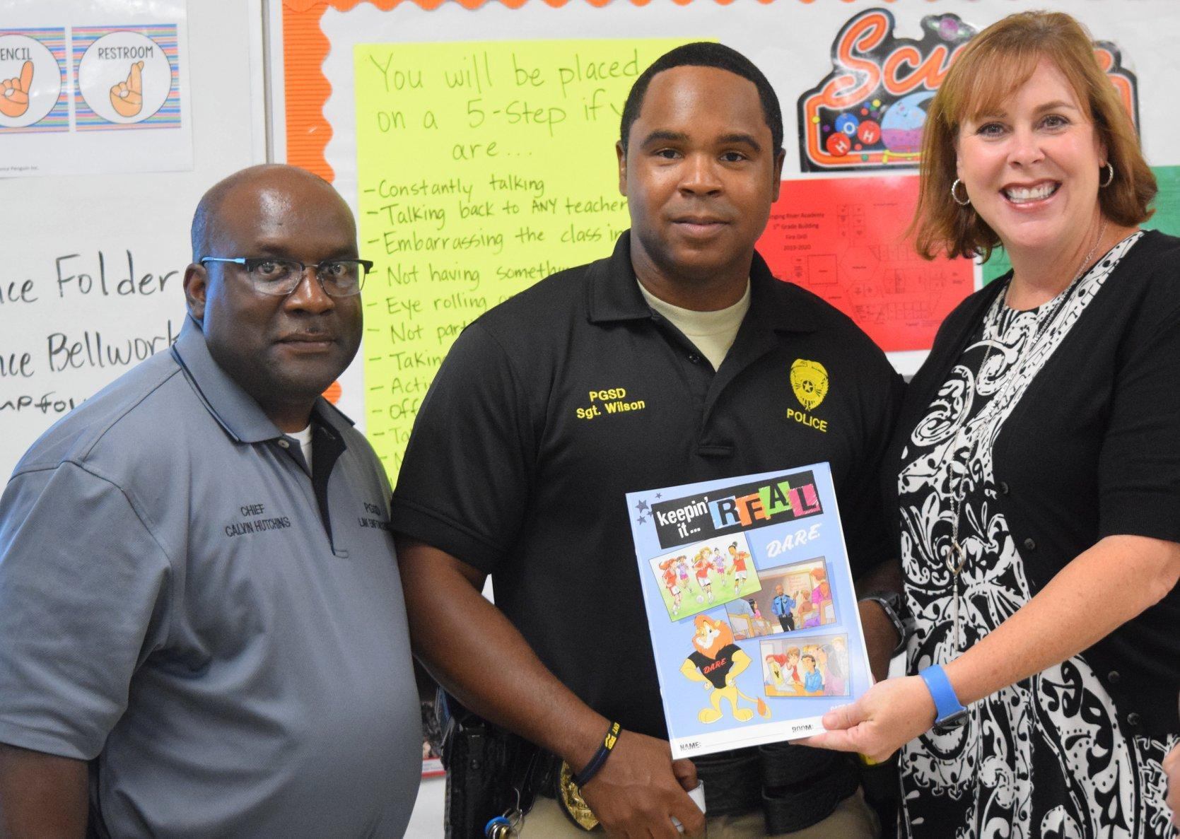 Chief Hutchins, Officer Wilson, Principal Rone