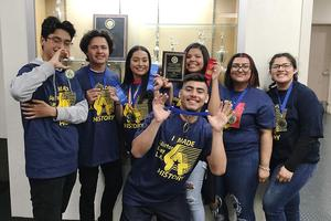 Seven Del Mar students pose with their ribbon and plaque awards.