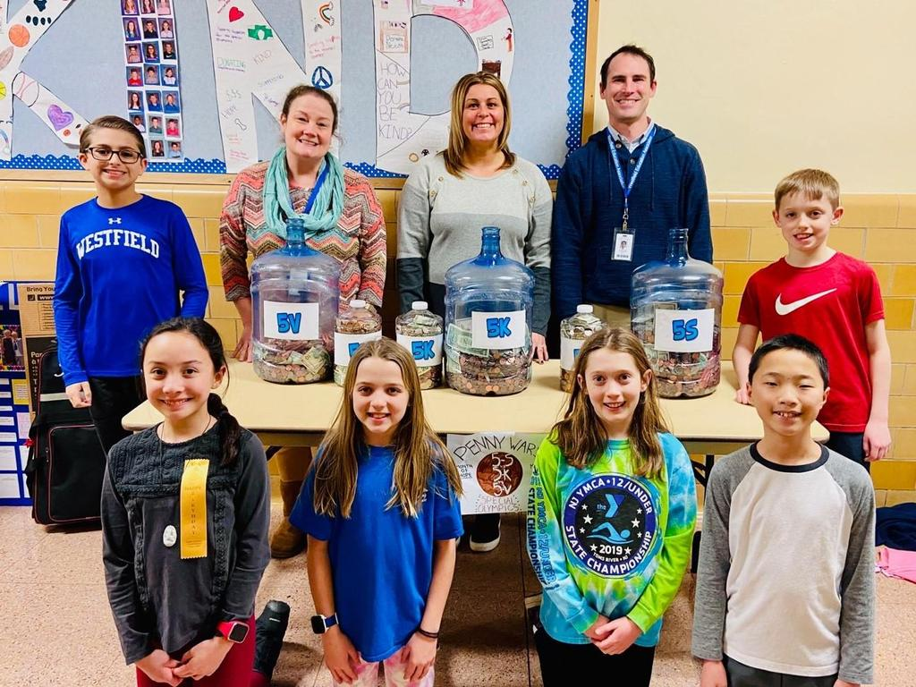 Photo of 5th grade teachers and students with jars of pennies collected for Special Olympics during Month of Hope
