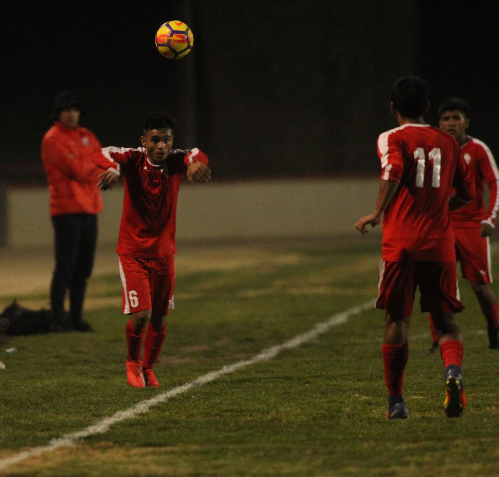 Arwin Brizo hitting the ball