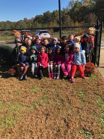 Pumpkin picking in our DAELC patch!
