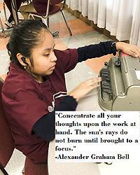 "Image: Student of a young NYI student being tested during the Braille Challenge. ""Concentrate all your thoughts upon the work at hand. The sun's rays do not burn until brought to a focus."" -Alexander Graham Bell"