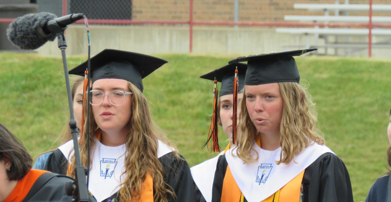Senior Honors Choir students join in a song at graduation.