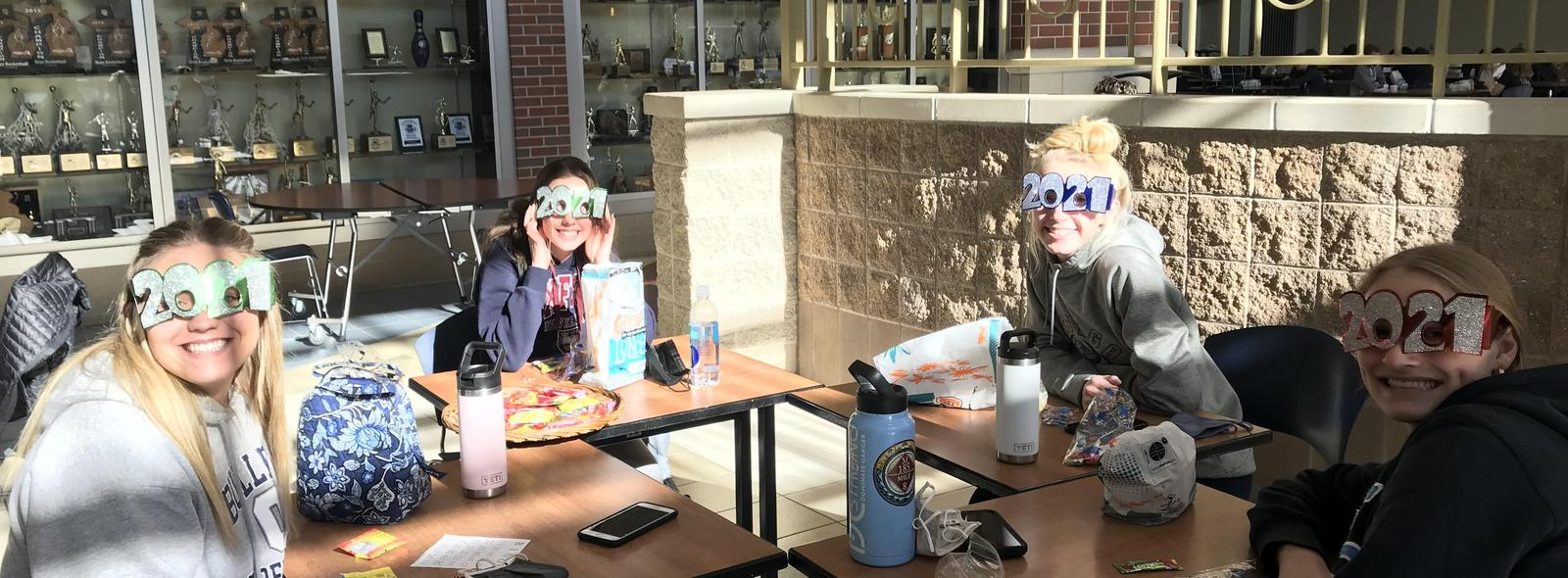 seniors at lunch with 2021 silly glasses on