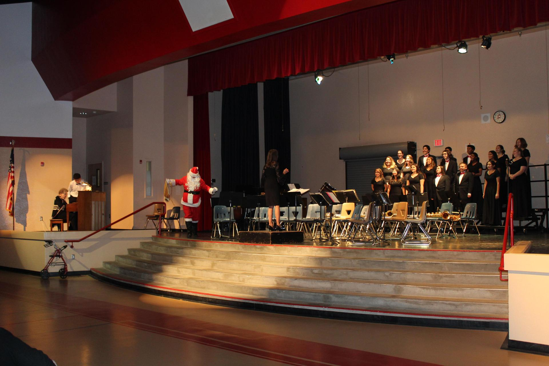 Santa appears on stage with the CUHS Choir.
