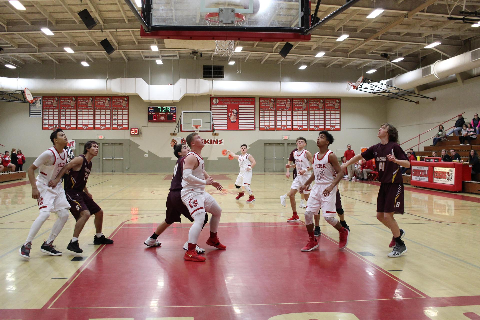 Varsity boys playing basketball against Sierra