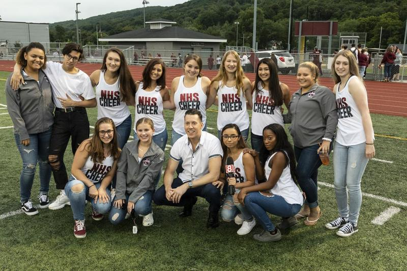 Cheerleaders with Channel 8 newsman