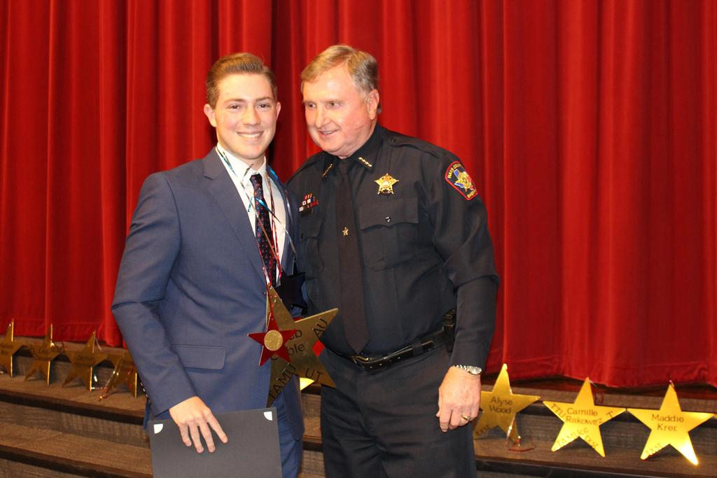 Hays County Sheriff's Scholarship Fund $1,000 Recipient Caleb Cable and Hays County Sheriff Gary Cutler