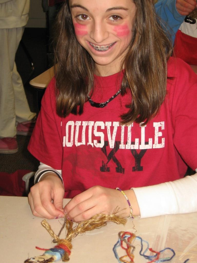 girl with braces creates a doll