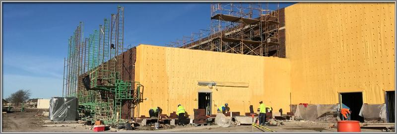 spray foam and brick go up on walls of Simpson Elementary