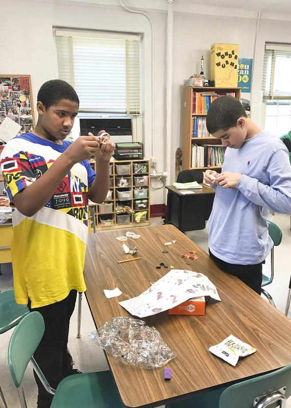 Two students busy on their project
