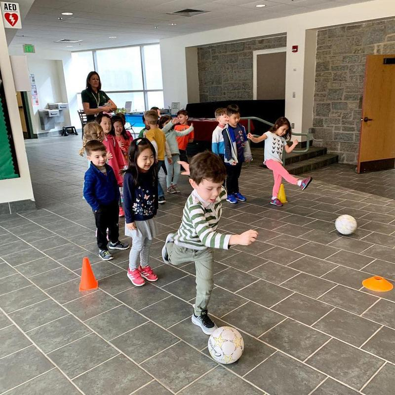 Preschoolers playing indoor soccer