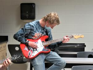 Some students spent the afternoon playing guitar.
