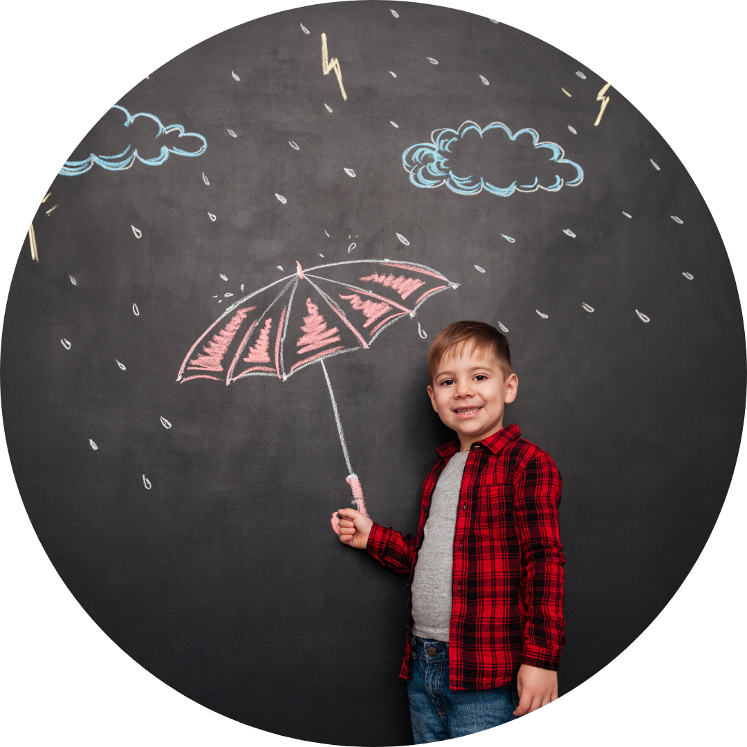 young boy looks like he is holding an umbrella drawn on blackboard with chalk