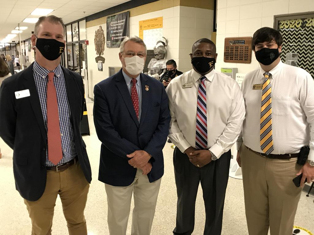 posed with administrators